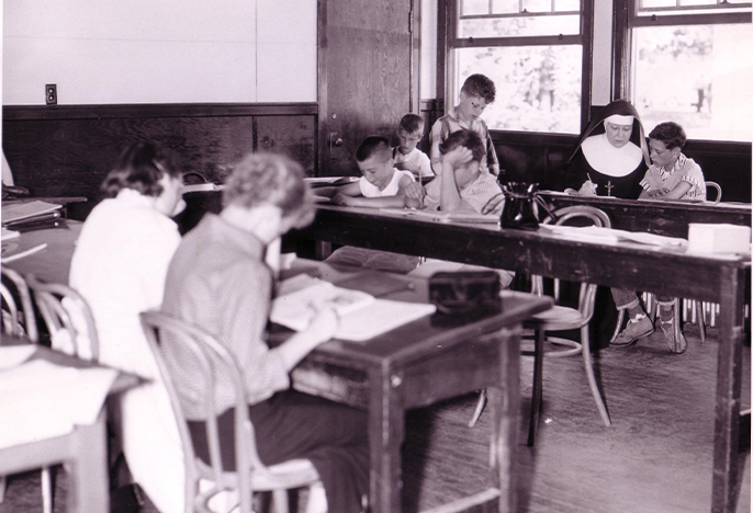 Pre-1960s classroom with students at desks