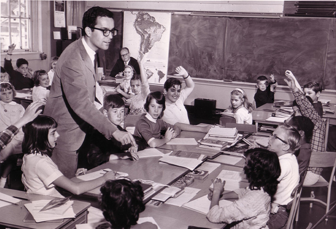 Male teacher in elementary classroom circa 1964