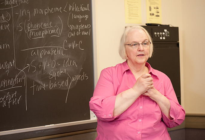 Female faculty member teaching a class