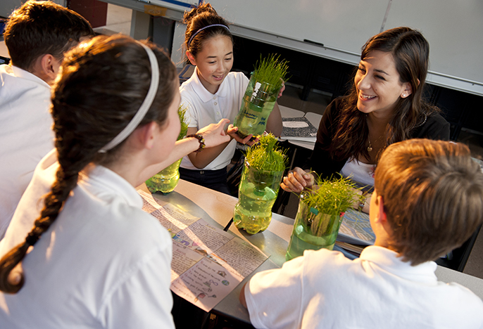 Education student Hannah Fink teaching students about plants