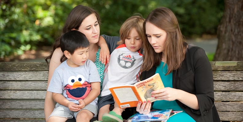 UP Students reading to kids